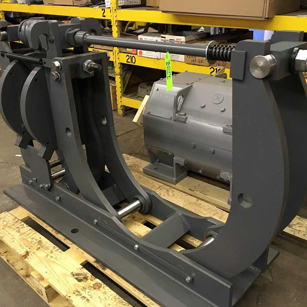 refurbished 30-inch industrial motor brake on skid in repair shop